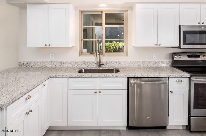 White Kitchen Cabinets With Gray Quartz Countertops