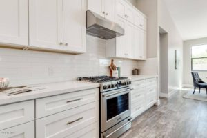 White Shaker Kitchen Cabinets Quartz Countertops Waterfall legs on island
