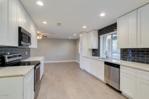 White Shaker Cabinets Light Countertops & dark backsplash